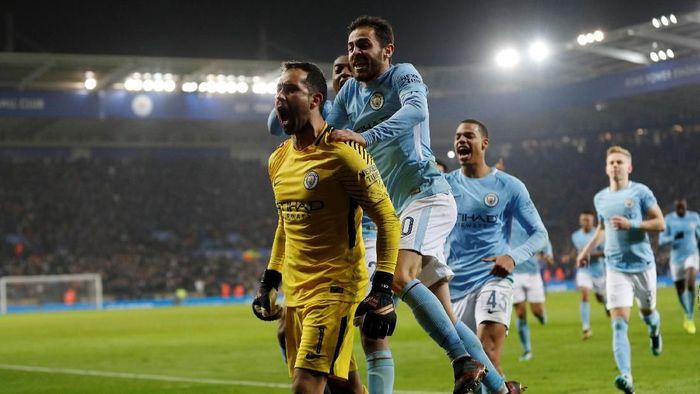 Manchester City mengalahkan Leicester City dalam adu penalti di perempatfinal Piala Liga Inggris (Darren Staples/Reuters)