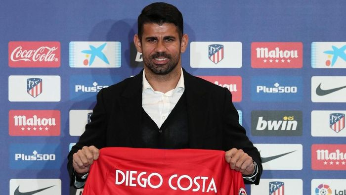 Atletico Madrids soccer player Diego Costa poses with his jersey for the media at Wanda Metropolitano stadium in Madrid, Spain, December 31, 2017. REUTERS/Susana Vera