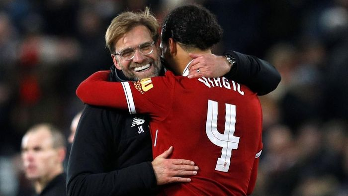 Soccer Football - FA Cup Third Round - Liverpool vs Everton - Anfield, Liverpool, Britain - January 5, 2018   Liverpool manager Juergen Klopp celebrates with Virgil van Dijk at the end of the match   REUTERS/Phil Noble