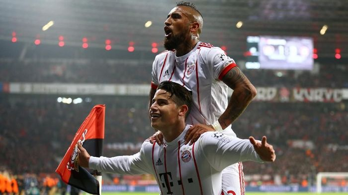 Soccer Football - Bundesliga - Bayer Leverkusen vs Bayern Munich - BayArena, Leverkusen, Germany - January 12, 2018   Bayern Munichs James Rodriguez celebrates scoring their third goal with Arturo Vidal     REUTERS/Wolfgang Rattay    DFL RULES TO LIMIT THE ONLINE USAGE DURING MATCH TIME TO 15 PICTURES PER GAME. IMAGE SEQUENCES TO SIMULATE VIDEO IS NOT ALLOWED AT ANY TIME. FOR FURTHER QUERIES PLEASE CONTACT DFL DIRECTLY AT + 49 69 650050