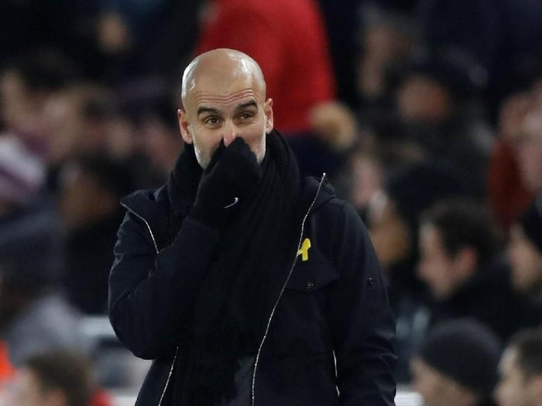 Dikritik Neville, Guardiola Sindir Pengalaman Melatih 4 Bulan