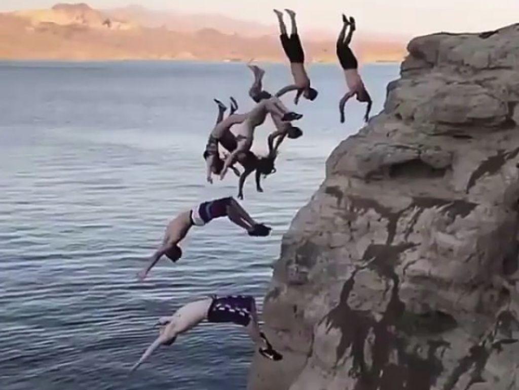 Foto: Beragam Olahraga Unik, Terjun Bareng Sampai Terbang di Kepala
