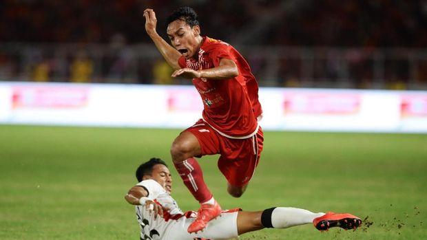 Novri Setiawan mencetak gol ketiga Persija ke gawang Bali United dalam laga final Piala Presiden 2018.