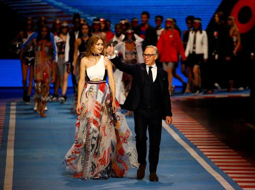 Saat Gigi Hadid Rancang Busana Terinspirasi Formula 1 untuk Tommy Hilfiger