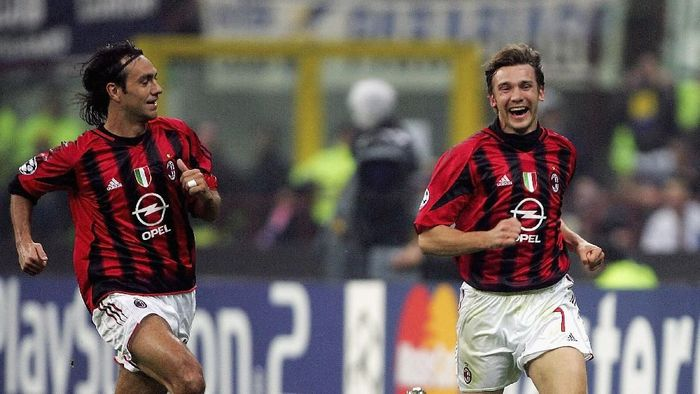 MILAN, ITALY -  APRIL 12:  Andriy Shevchenko (R) of AC Milan celebrates with team-mate Alessandro Nesta after scoring during the UEFA Champions League quarter-final second leg between AC Milan and Inter Milan at the San Siro Stadium on April 12, 2005  in Milan, Italy. (Photo by Mike Hewitt/Getty Images)