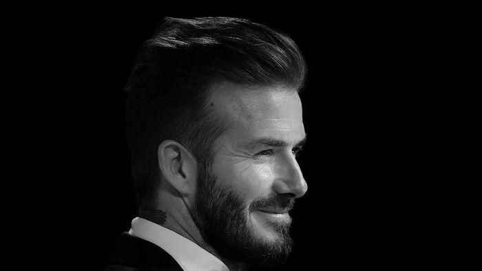 Kemampuan bersepakbola dan paras tampannya ikut mengantar David Beckham main di sejumlah film. Sebut saja Goal II: Living the Dream, Goal III: Taking on the World, The Man from U.N.C.L.E. (cameo supersingkat), dan King Arthur: Legend of the Sword. (Foto: Gareth Cattermole/Getty Images)