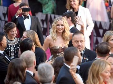 Jennifer Lawrence saat tampil di Oscar 2018 di Hollywood, California, AS pada Minggu (4/3) waktu setempat. Matt Winkelmeyer/Getty Images.