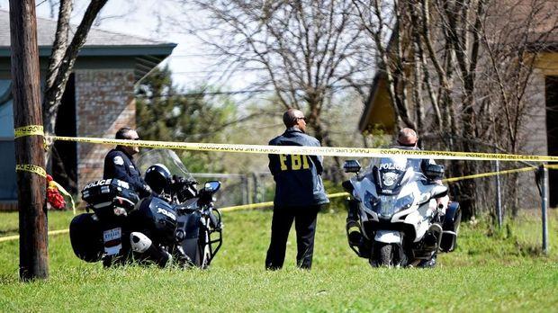 Polisi dan FBI menjaga lokasi serangan