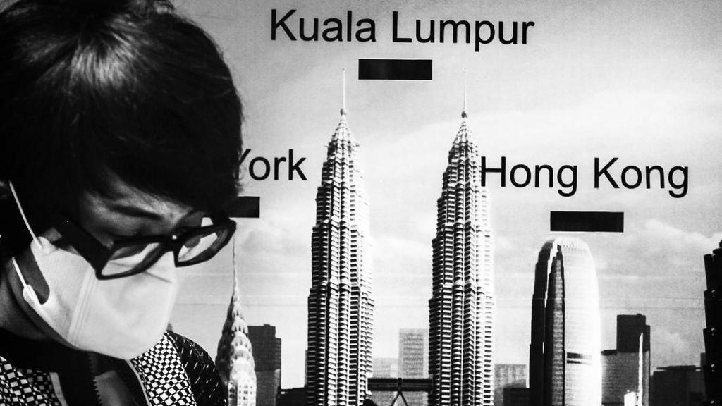 Potret Hitam-Putih Kisah Buruh Migran di Malaysia