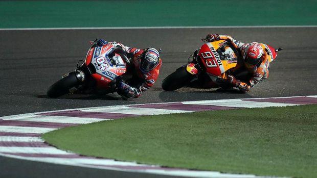 Andrea Dovizioso menyajikan duel sengit melawan Marc Marquez di MotoGP Qatar.