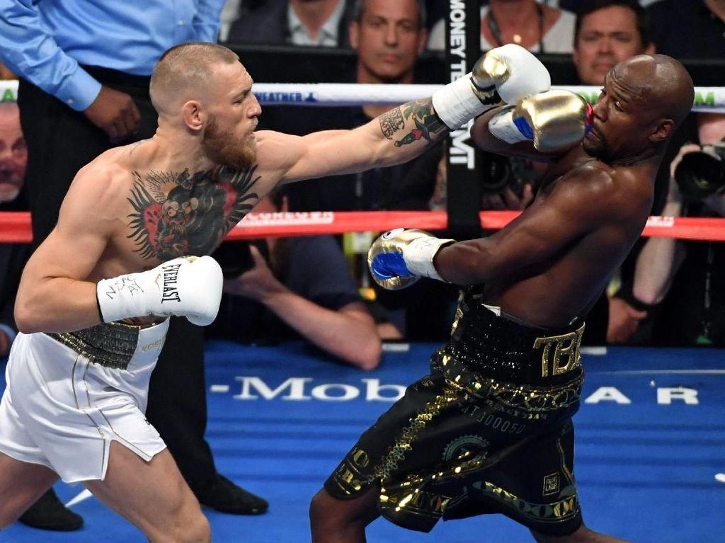 Dipuji Mike Tyson, McGregor Ingin Tanding Ulang dengan Mayweather