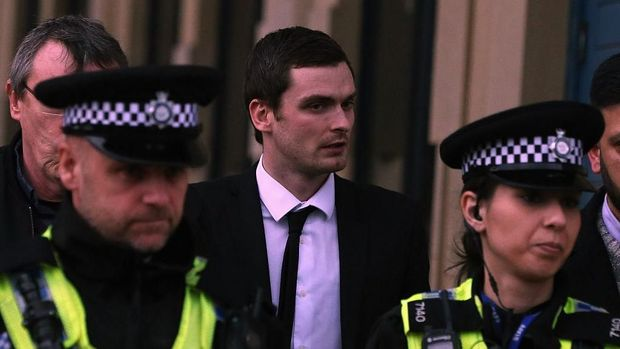 BRADFORD, ENGLAND - MARCH 01:  Footballer Adam Johnson (C) leaves Bradford Crown Court during day thirteen of the trial where he is facing child sexual assault charges on March 1, 2016 in Bradford, England. The former Sunderland FC midfielder, 28, from Castle Eden, County Durham, has admitted one charge of sexual activity with a child and one charge of child grooming, but denies two further counts of sexual activity with a child.  (Photo by Nigel Roddis/Getty Images)