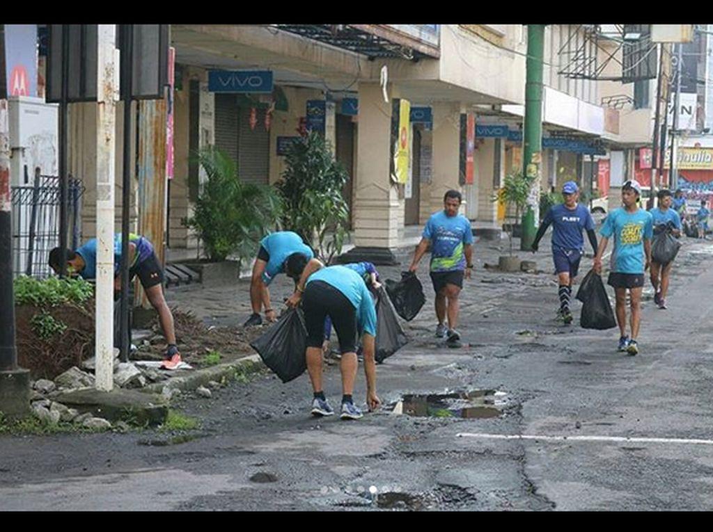 Mengenal Plogging, Olahraga Sambil Pungut Sampah yang Kekinian