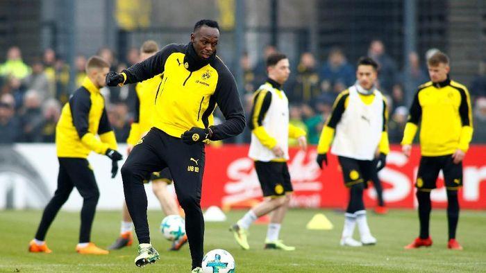 Usain Bolt berlatih bareng Borussia Dortmund (Thilo Schmuelgen/Reuters)