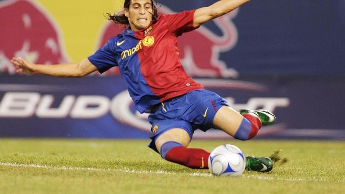 EAST RUTHERFORD, NJ - AUGUST 06:  Jose Martin Caceres #2 of FC Barcelona slides into the ball against the New York Red Bulls at Giants Stadium in the Meadowlands on August 6, 2008 in East Rutherford, New Jersey. Barcelona won 6-2.  (Photo by Mike Stobe/Getty Images for New York Red Bulls)