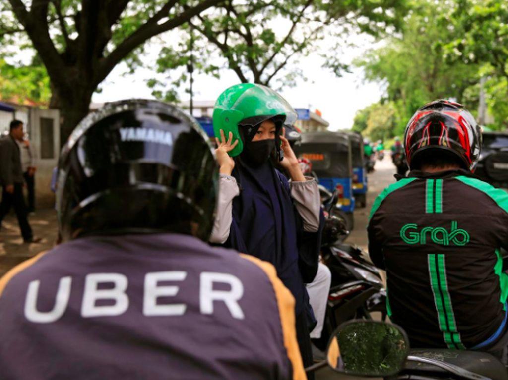 Singapura dan Malaysia Selidiki Grab Akuisisi Uber