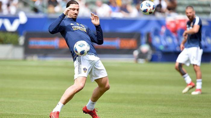 Zlatan Ibrahimovic kalah taruhan dari David Beckham di Piala Dunia 2018 (Foto: Gary A. Vasquez-USA TODAY Sports)