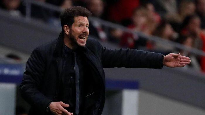 Diego Simeone akan menghadapi pelatih Real Madrid yang kelima sejak ditunjuk Atletico Masd dengan pelatih Foto: Javier Barbancho/Reuters