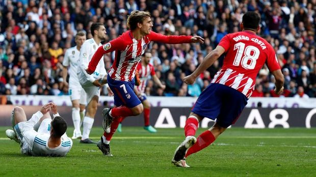 Antoine Griezmann mencetak gol penyeimbang Atletico Madrid.