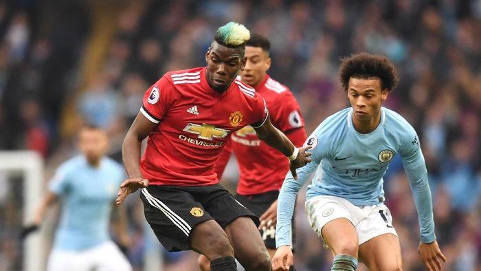 Paul Pogba dan Leroy Sane di Manchester City vs Manchester United musim lalu. (Foto: Michael Regan/Getty Images)