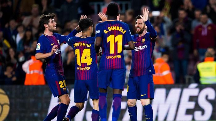 BARCELONA, SPAIN - APRIL 07:  Lionel Messi of FC Barcelona celebrates with teammates after scoring his teams second goal during the La Liga match between Barcelona and Leganes at Camp Nou on April 7, 2018 in Barcelona, Spain.  (Photo by Alex Caparros/Getty Images)