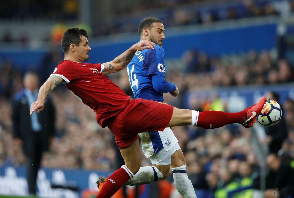 Soccer Football - Premier League - Everton vs Liverpool - Goodison Park, Liverpool, Britain - April 7, 2018   Everton's Cenk Tosun in action with Liverpool's Dejan Lovren   Action Images via Reuters/Carl Recine    EDITORIAL USE ONLY. No use with unauthorized audio, video, data, fixture lists, club/league logos or