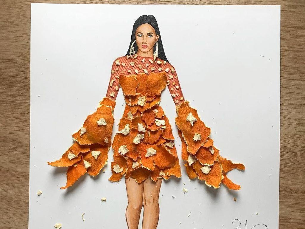 Keren! Lukisan Wanita Ini Diberi Baju dari Susunan Buah dan Kulitnya