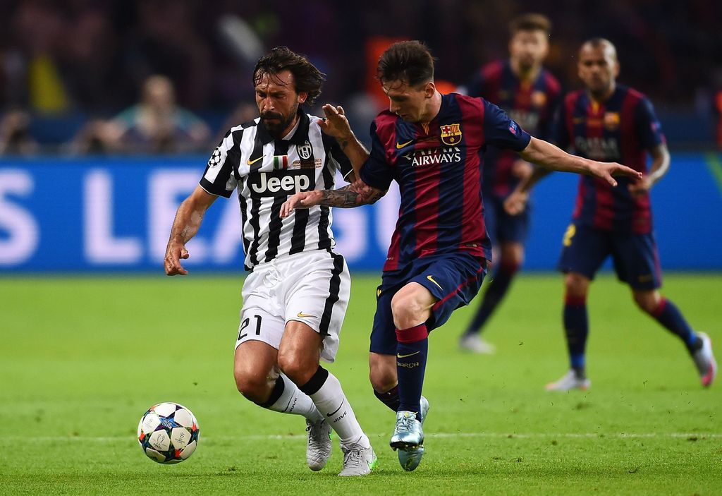 BERLIN, GERMANY - JUNE 06:  Lionel Messi of Barcelona tackles Andrea Pirlo of Juventus during the UEFA Champions League Final between Juventus and FC Barcelona at Olympiastadion on June 6, 2015 in Berlin, Germany.  (Photo by Laurence Griffiths/Getty Images)