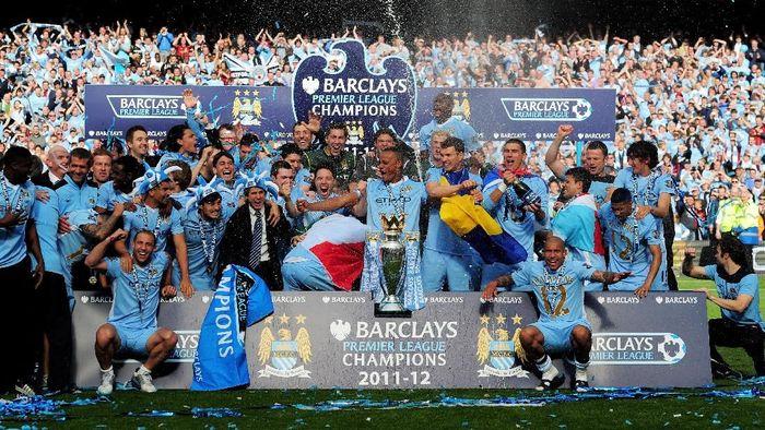 Manchester City melakukan perayaan gelar juara Liga Inggris di musim lalu (Shaun Botterill/Getty Images)
