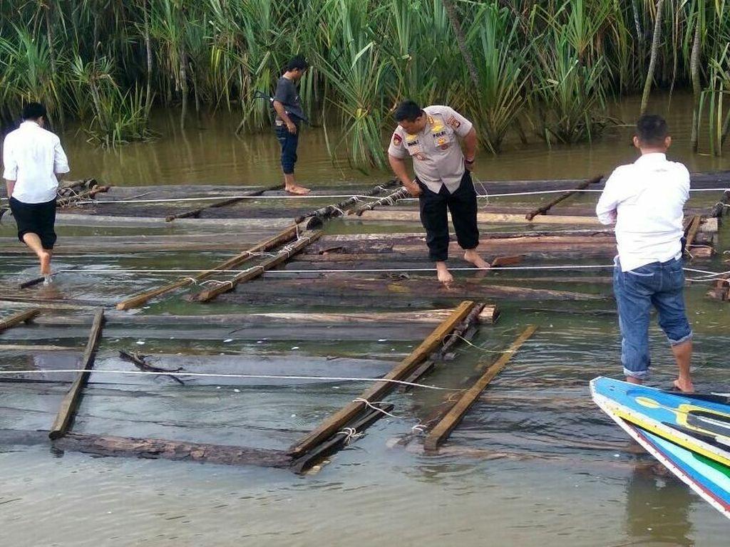 Pemilik Ribuan Kayu di Sungai Musi Masih Misterius