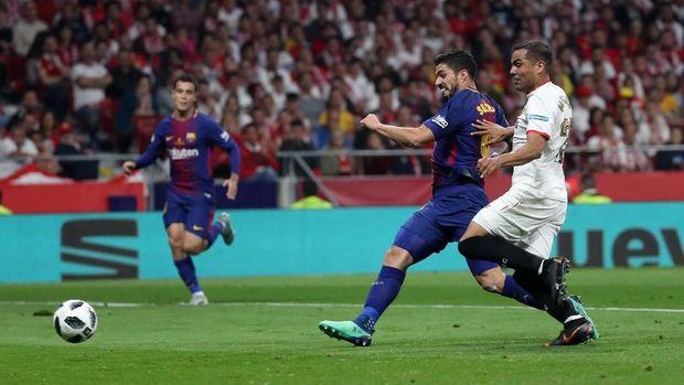 Luis Suarez menyumbang dua gol dalam laga final melawan Sevilla.