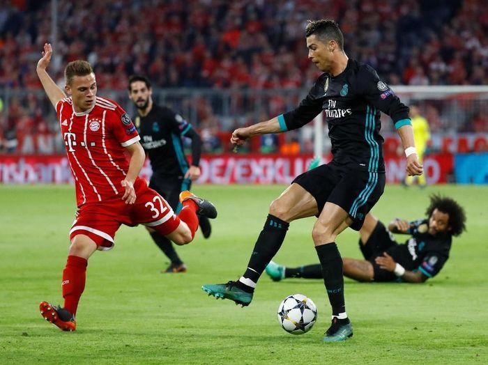 El Real menang 2-1 saat melawat ke markas Bayern di leg I semifinal Liga Champions. Ronaldo tak membukukan gol di laga itu. (Foto: Kai Pfaffenbach/Reuters)