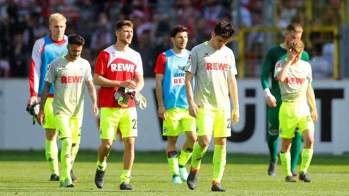 Cologne dipastikan terdegradasi dari Bundesliga setelah kalah dari Freiburg (Foto: Kai Pfaffenbach/Reuters)