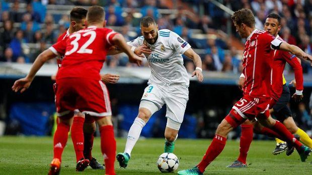 Karim Benzema mencetak dua gol pada pertandingan leg kedua semifinal Liga Champions menghadapi Bayern Munchen.