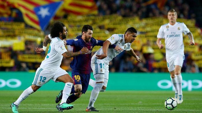 Lionel Messi tak mau menukar trofi-trofi domestik Barcelona dengan gelar juara Liga Champions. (Foto: Albert Gea/REUTERS)