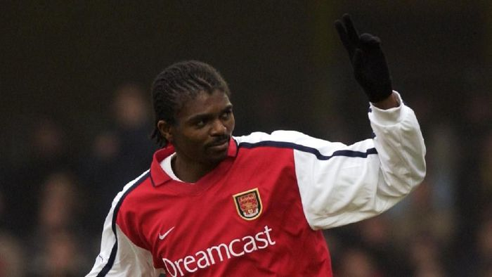 5 Jan 2002:  Nwankwo Kanu of Arsenal celebrates scoring the third goal during the AXA sponsored FA Cup third round match against Watford played at Vicarage Road, in Watford, England. Arsenal won the match 4-2. DIGITAL IMAGE. Mandatory Credit: Stu Forster/Getty Images