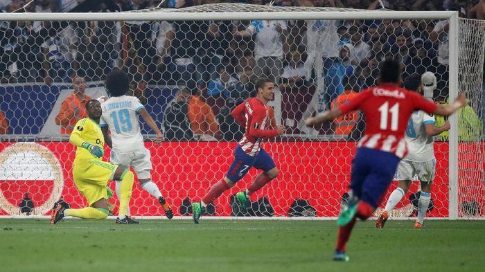 Antoine Griezmann membawa Atletico Madrid unggul 1-0 atas Marseille di babak pertama (Foto: Christian Hartmann/Reuters)
