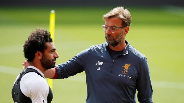 Juergen Klopp dan Mohamed Salah. (Foto: Andrew Yates/Reuters)