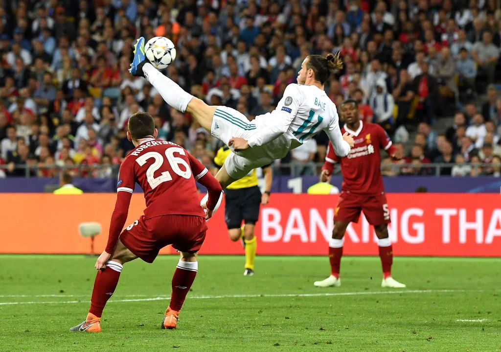 KIEV, UKRAINE - MAY 26:  Gareth Bale of Real Madrid shoots and scores his side's second goal during the UEFA Champions League Final between Real Madrid and Liverpool at NSC Olimpiyskiy Stadium on May 26, 2018 in Kiev, Ukraine.  (Photo by David Ramos/Getty Images)