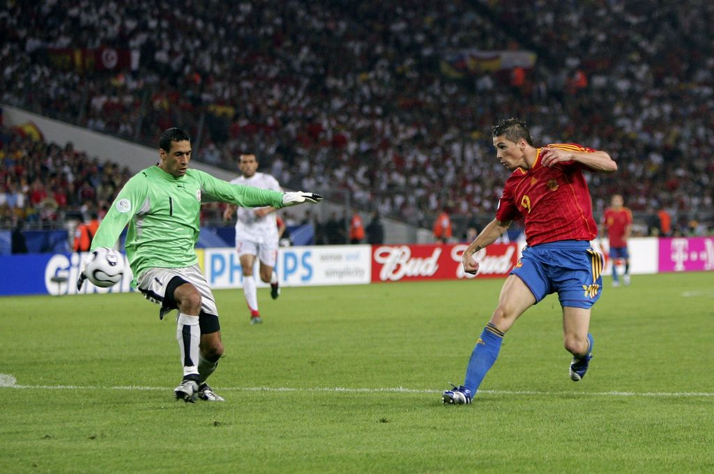 STUTTGART, GERMANY - JUNE 19:  Fernando Torres (R) of Spain, scores his team's second goal past Goalkeeper Ali Boumnijel of Tunisia during the FIFA World Cup Germany 2006 Group H match between Spain and Tunisia at the Gottlieb-Daimler Stadium on June 19, 2006 in Stuttgart, Germany.  (Photo by Michael Steele/Getty Images)