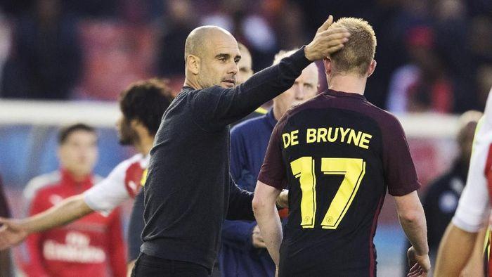Kevin de Bruyne membela Josep Guardiola dari tuduhan Yaya Toure. (Foto: Nils Petter Nilsson/Ombrello/Getty Images)
