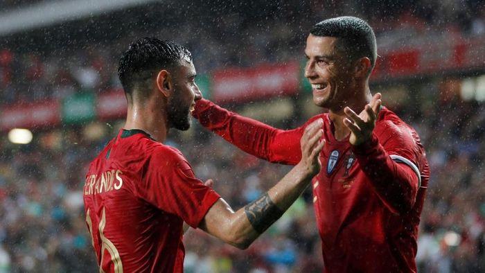 Portugal kalahkan Aljazair 3-0. (Foto: Rafael Marchante/Reuters)