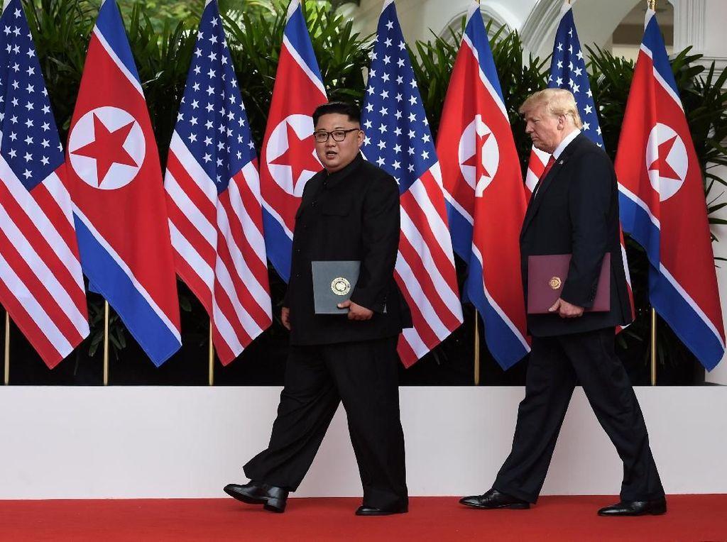 Trump Minta Terlihat Kurus Saat Difoto, Begini Ekspresi Kim Jong Un