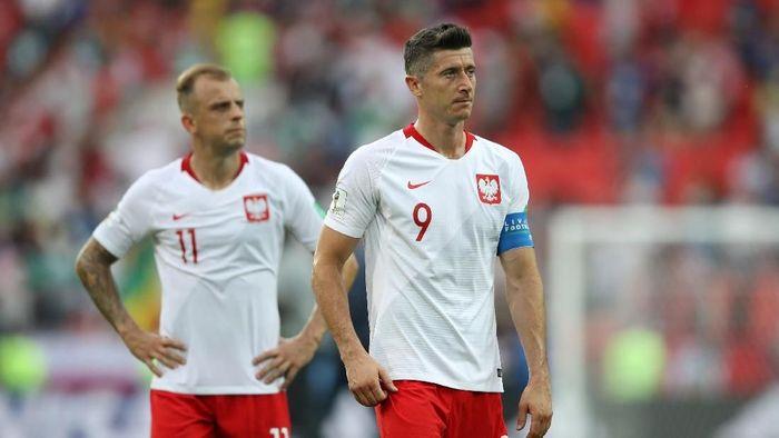 Kekecewaan Robert Lewandowski setelah Polandia dikalahkan Senegal (Foto: Carl Recine/Reuters)