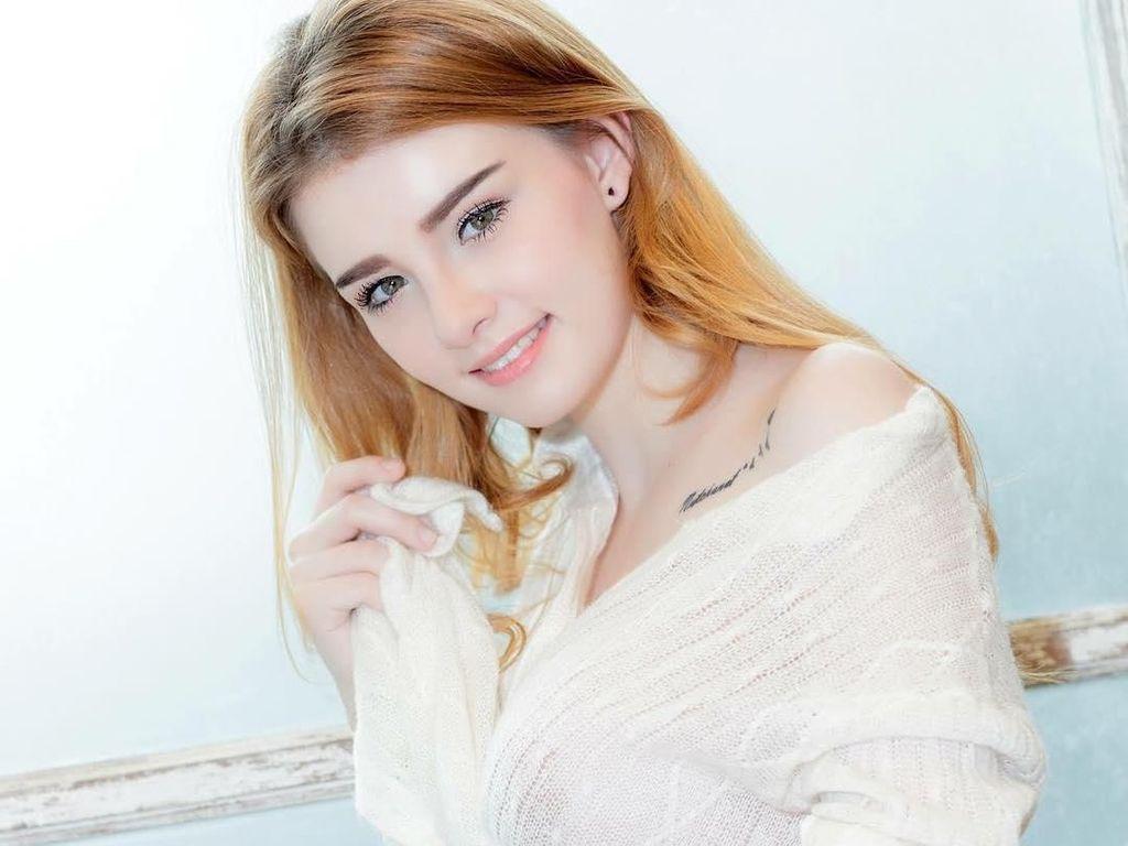 Sosok Model Cantik yang Dipolisikan karena Promosi Judi Online Piala Dunia