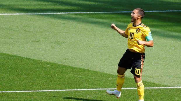 Eden Hazard merayakan gol ke gawang Tunisia.