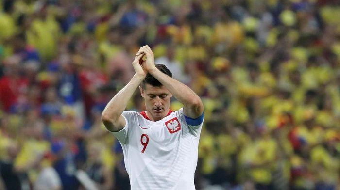 Robert Lewandowski tak mampu menyelamatkan Polandia dari kekalahan telak pada laga melawan Kolombia (Foto: Toru Hanai/Reuters)