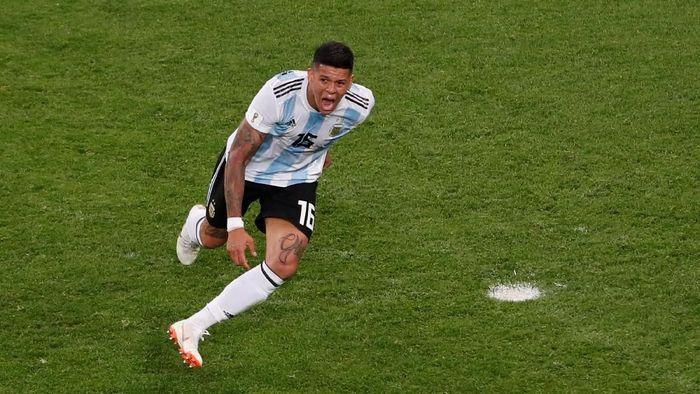 Marcos Rojo nyaris membawa bencana untuk Argentina, namun kemudian jadi pahlawan (REUTERS/Lee Smith)