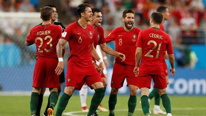 Portugal butuh satu poin dari lawatannya ke markas Italia. (Foto: Matthew Childs/Reuters)