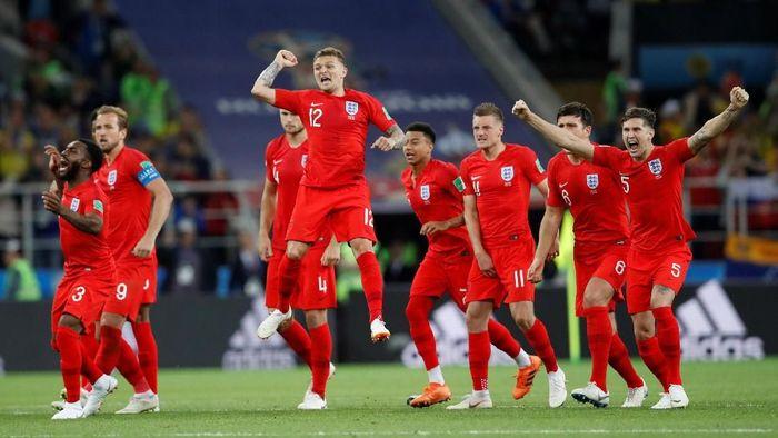 Para pemain Inggris merayakan keberhasilan dalam adu penalti vs Kolombia (Foto: Carl Recine/Reuters)